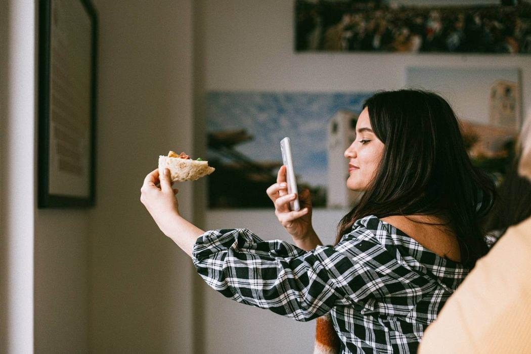 Micro-influencer taking a photo of food