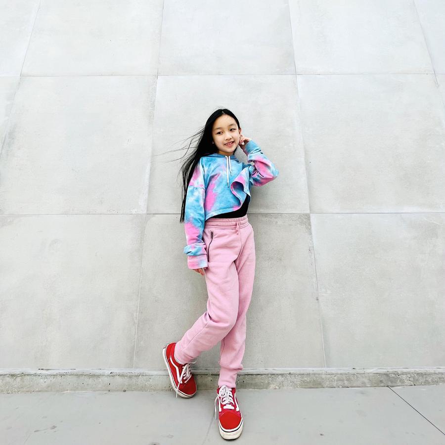 Instagram  creator Malea Emma being photographed