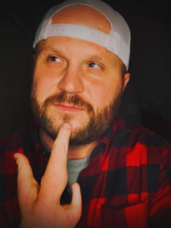 TikTok  creator Zach Fischer being photographed