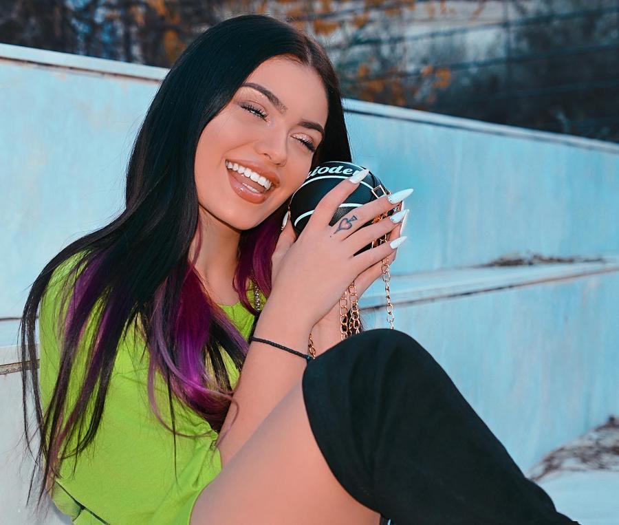 TikTok  creator Asimina L being photographed