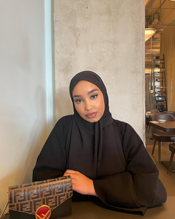 Instagram  creator Manal Sharif being photographed