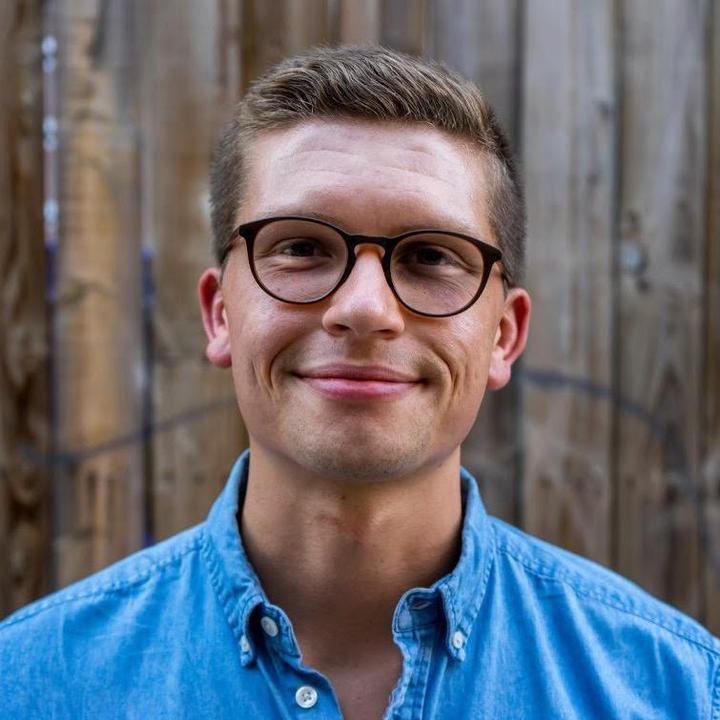 TikTok  creator Alex Schroeder being photographed