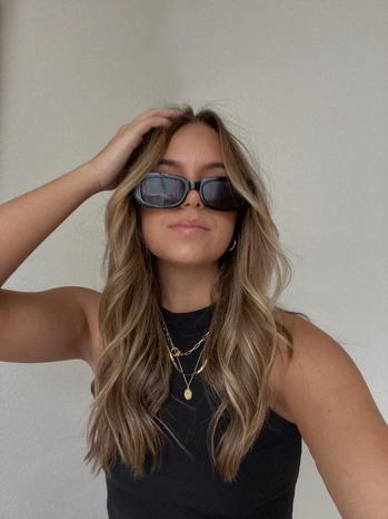 fashion creator Gabriella Cullyne Gonzalez being photographed
