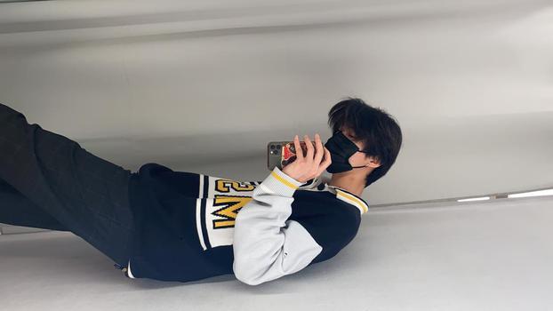 TikTok  creator Hanlin Ni being photographed