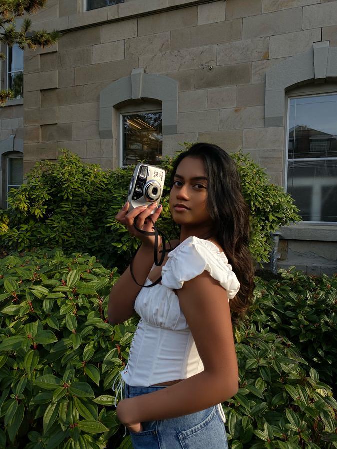 Instagram  creator Genevieve D'Souza being photographed